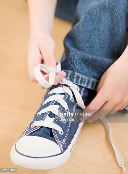 close up of child tying shoe - children only stock pictures, royalty-free photos & images
