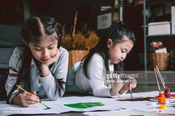 close up of childern painting together - japanese art stock pictures, royalty-free photos & images
