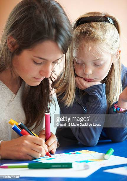 close up of children drawing indoors - saint ferme stock pictures, royalty-free photos & images