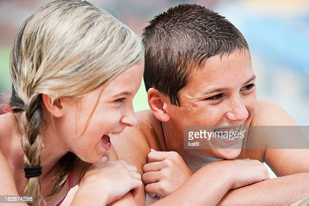 Close up of children laughing at pool