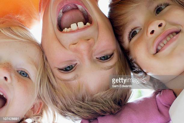 close up of children smiling - three people stock pictures, royalty-free photos & images