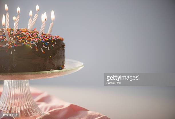 Close up of chocolate birthday cake with candles