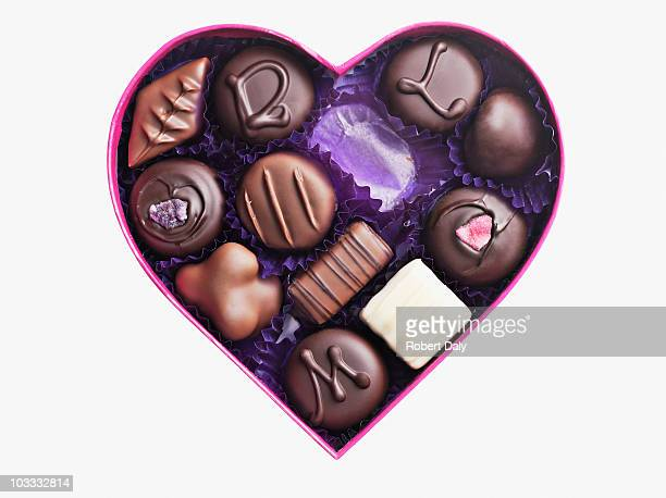 close up of chocolates in heart-shape box - chocolate stock pictures, royalty-free photos & images