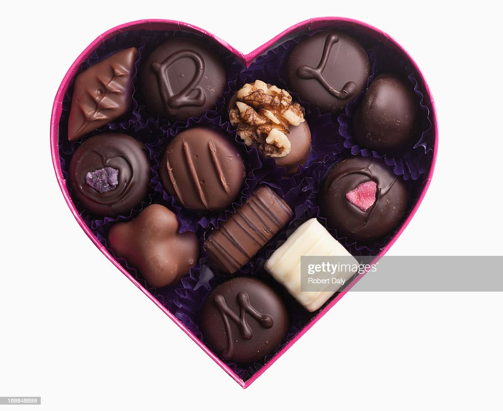 Close up of chocolates in heart-shape box : Stock Photo