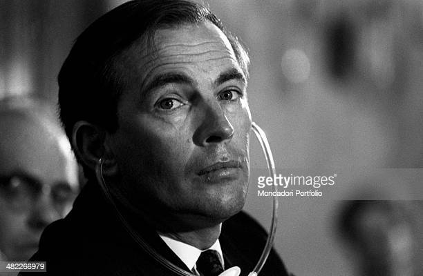 A close up of Christiaan Barnard the South African surgeon listening with headphones to the simultaneous translation during the congress on...