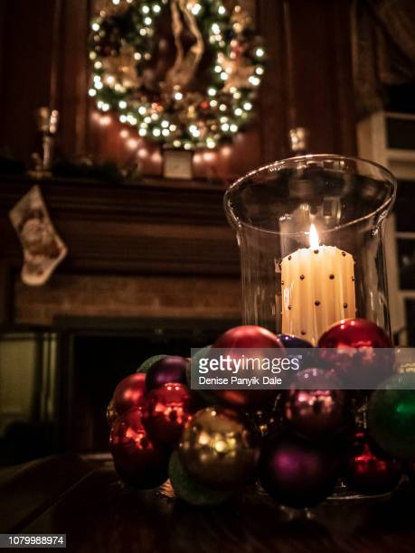 close up of christmas candle and decorations - panyik-dale stock photos and pictures