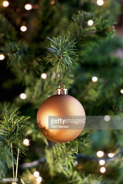 close up of christmas ornament on tree - christmas ornaments stock photos and pictures