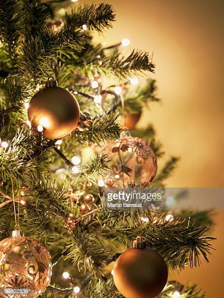 close up of christmas ornaments on tree - christmas tree stock pictures, royalty-free photos & images