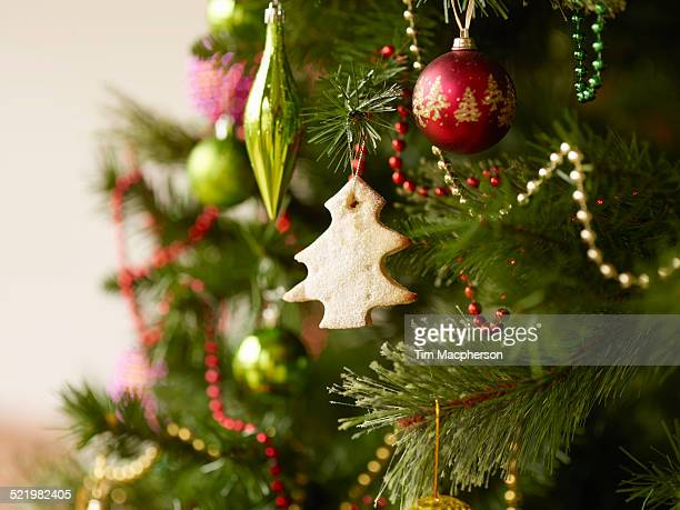 close up of christmas tree with baubles and christmas biscuits - christmas tree stock pictures, royalty-free photos & images
