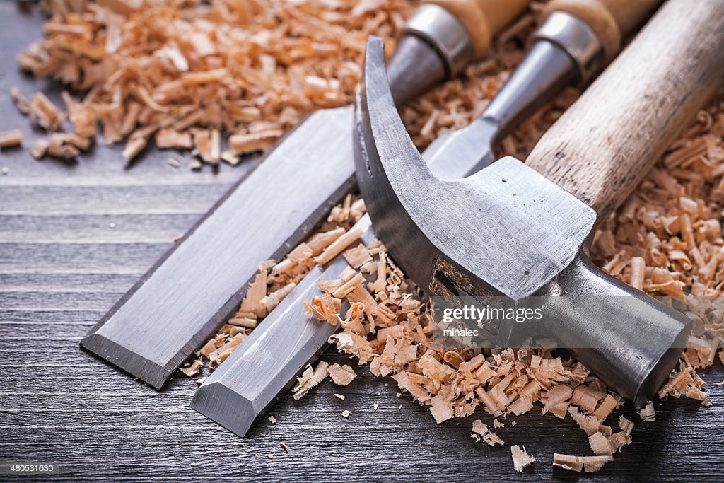 Close up of claw hammer and metal firmer chisels in : Stock Photo