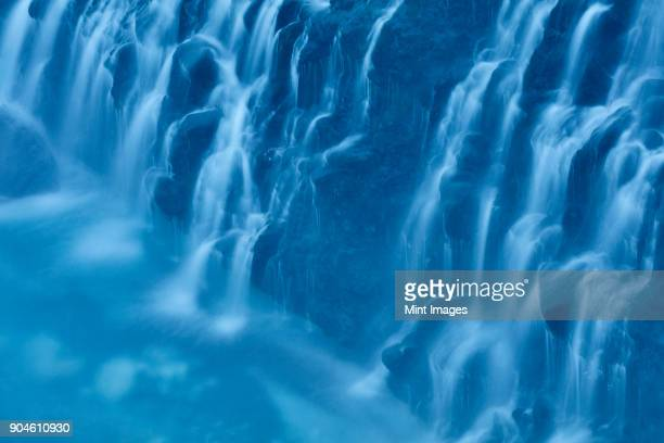 close up of cobalt blue water cascading at white beard waterfall, shirogane, biei. - biei town stock pictures, royalty-free photos & images