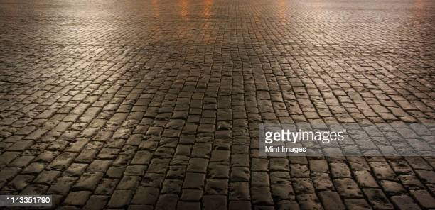 Close up of cobblestone street at night