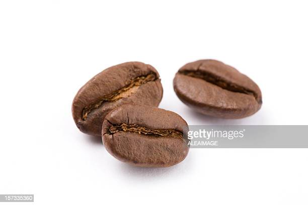 Close up of coffee beans against white background