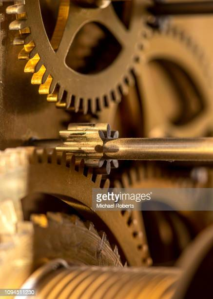 close up of cogs in long case clock - cog stock pictures, royalty-free photos & images