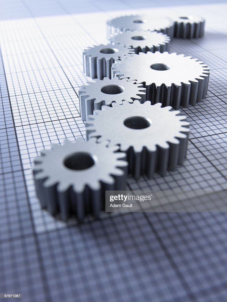 Close up of cogs on graph paper : Stock Photo