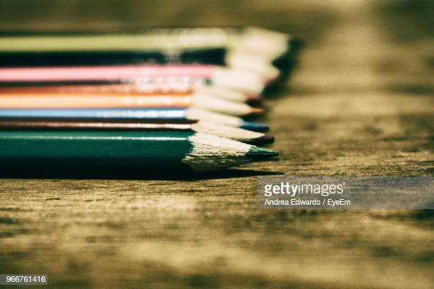 Close Up Of Colored Pencils On Wooden Table