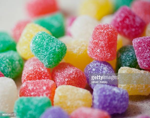 close up of colorful gum drops - gum drop stock photos and pictures