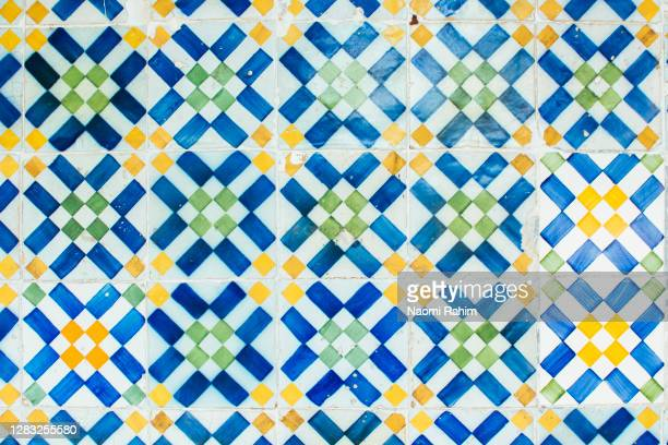 close up of colorful portuguese azulejos (ceramic tiles) on a wall in lisbon - mediterranean culture stock pictures, royalty-free photos & images
