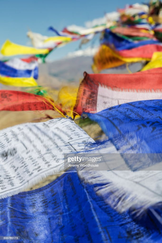 Close up of colorful prayer flags blowing in breeze : Foto stock