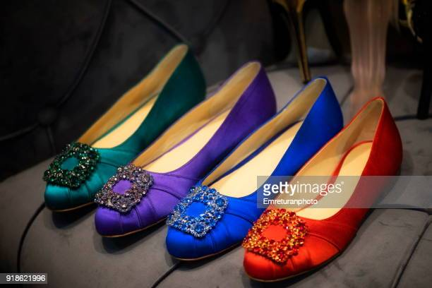 Close up of colorful women's shoes on shop window.