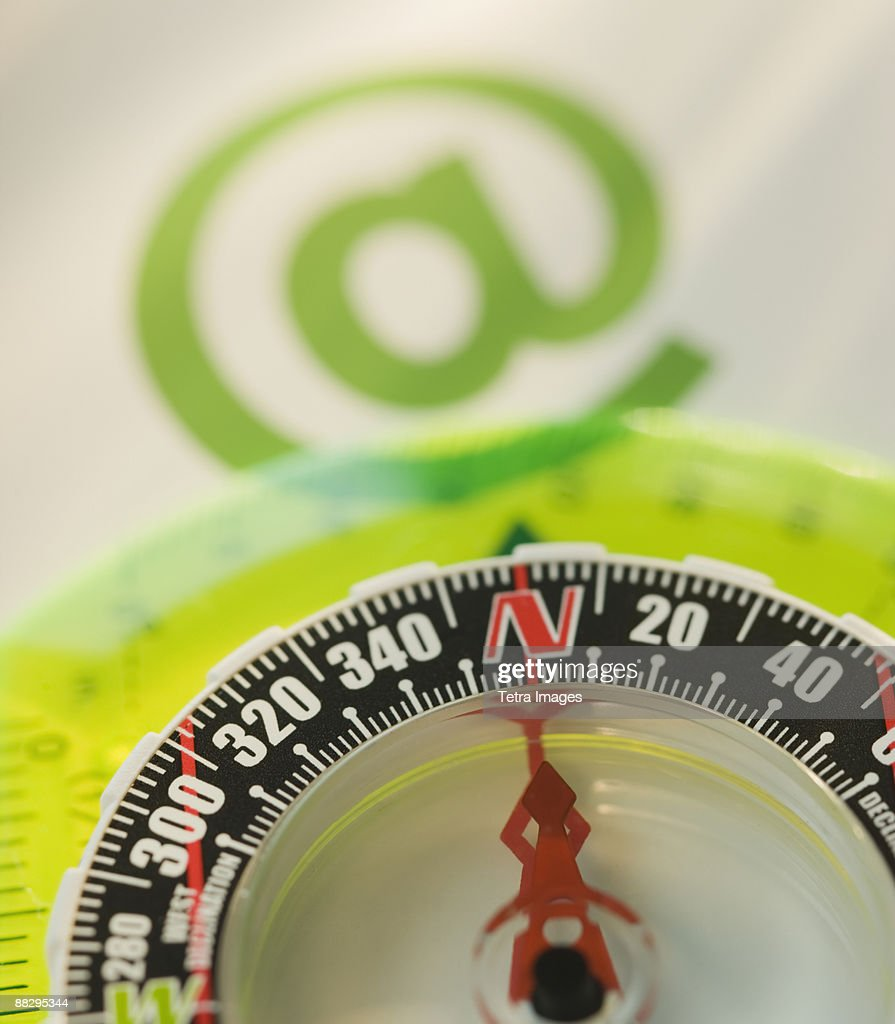 Close Up Of Compass And At Symbol Stock Photo Getty Images