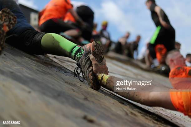 Close up of competitors helping each other during the 2017 Tough Mudder South West at Badminton Estate on August 20 2017 in Cirencester England
