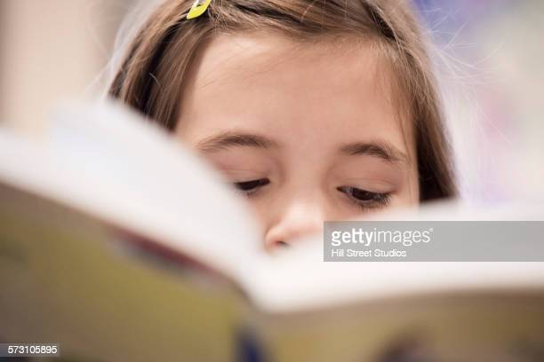 Close up of concentrating student reading