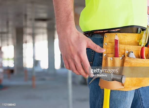 Close up of construction workers tool belt on construction site