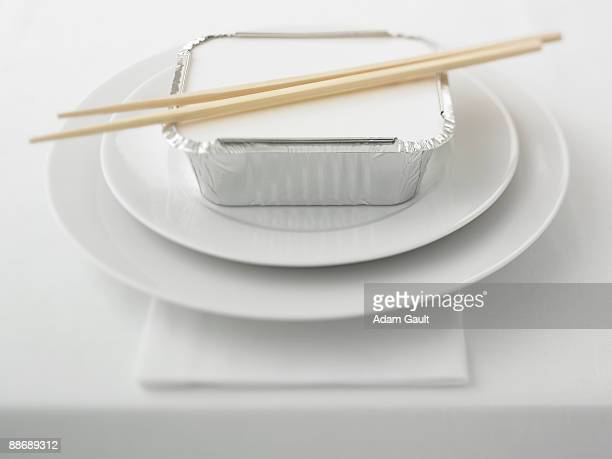 close up of container of asian food on plate - carton stock photos and pictures