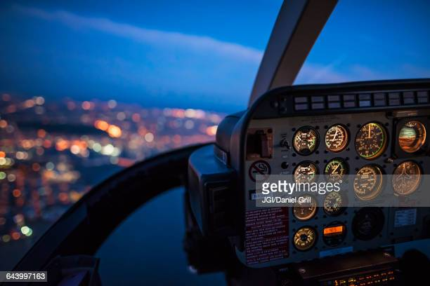 Close up of control panel of airplane flying at night
