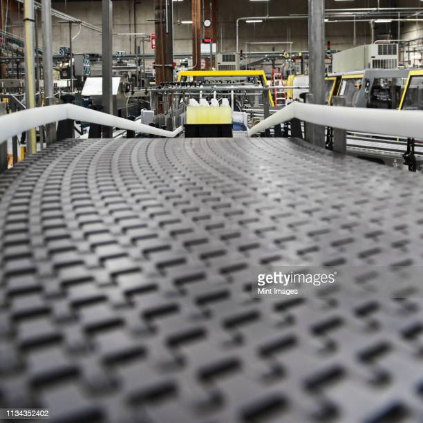 close up of conveyor belt in bottling plant - industrial storage bins stock pictures, royalty-free photos & images