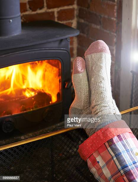 Close up of cosy socks in front of fire