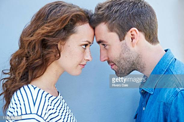 close up of couple forehead to forehead - angesicht zu angesicht stock-fotos und bilder