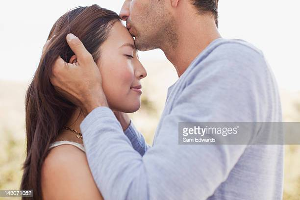 close up of couple kissing - forehead stock pictures, royalty-free photos & images