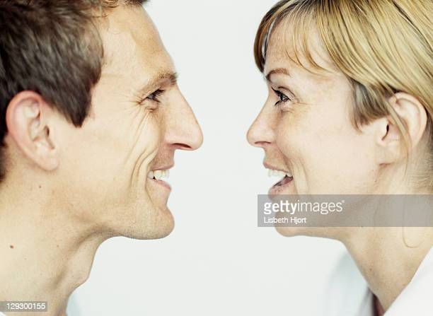 close up of couple laughing together - angesicht zu angesicht stock-fotos und bilder