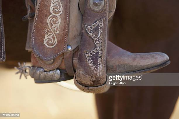 close up of cowboy boot in stirrup - hugh sitton stock pictures, royalty-free photos & images