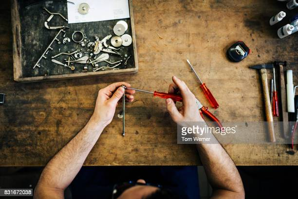 close up of craftsman putting parts together for musical instruments - screwdriver stock pictures, royalty-free photos & images