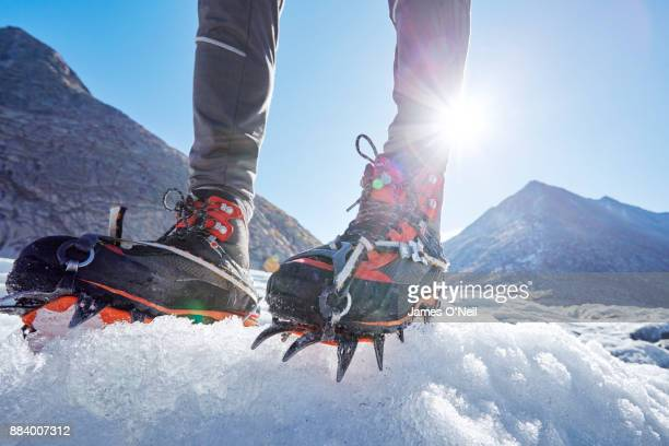 close up of crampons on ice, aletsch glacier, switzerland - 部分 ストックフォトと画像