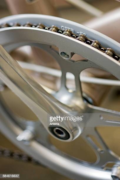 Close up of crankset showing chainring and chain, part of bicycle.