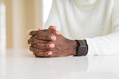 close up crossed hands african man