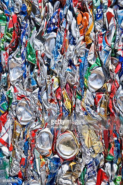 Close up of crushed and baled aluminum cans at a c