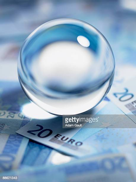 close up of crystal ball on 20 euro notes - twenty euro banknote stock photos and pictures