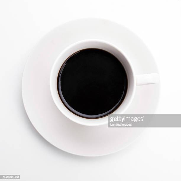 close up of cup of black coffee - saucer stock pictures, royalty-free photos & images