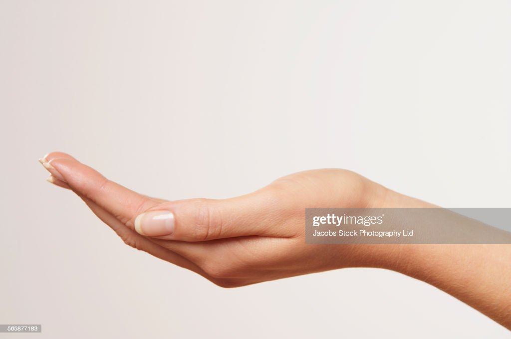 Close up of cupped hand of Caucasian woman : Stock Photo
