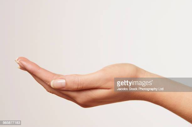 Close up of cupped hand of Caucasian woman