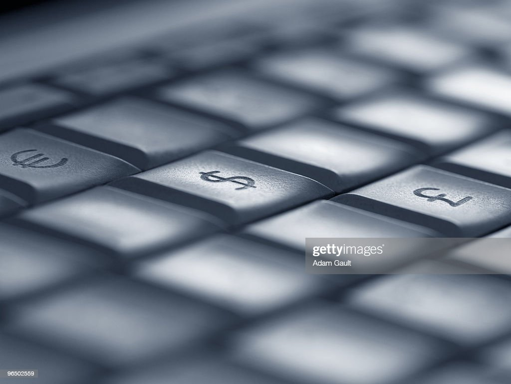 Close up of currency keys on computer keyboard : Stock Photo