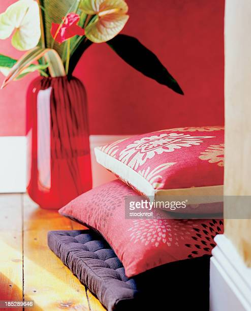Close up of cushions and vase