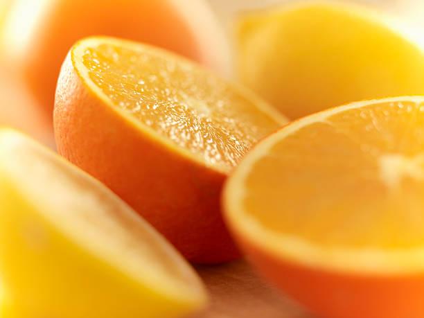 Close up of cut lemons and oranges