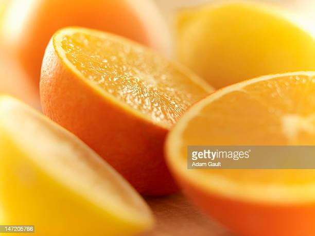 Close up of cut lemons and oranges