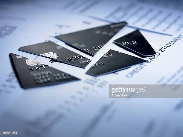 close up of cut pieces of credit card - bankruptcy stock pictures, royalty-free photos & images
